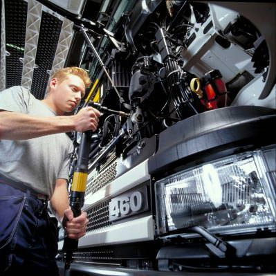 Engineer working on a large commercial vehicle