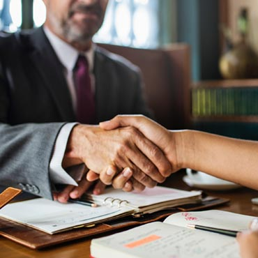 Shaking hands on a joint venture deal