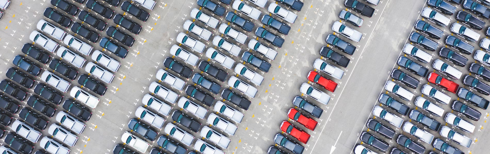 Cars parked in rows viewed from above