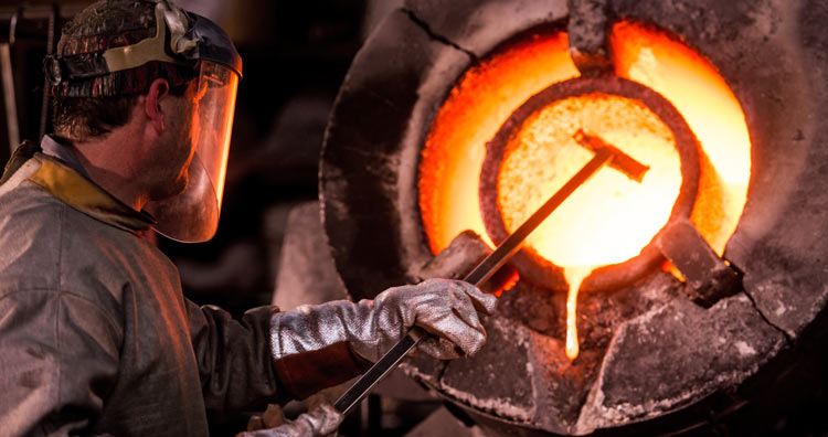 Man working in an industrial forge