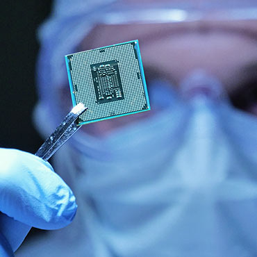 Engineer holding a microchip