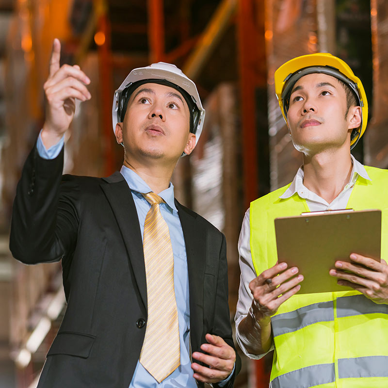 Men in discussion during a factory inspection