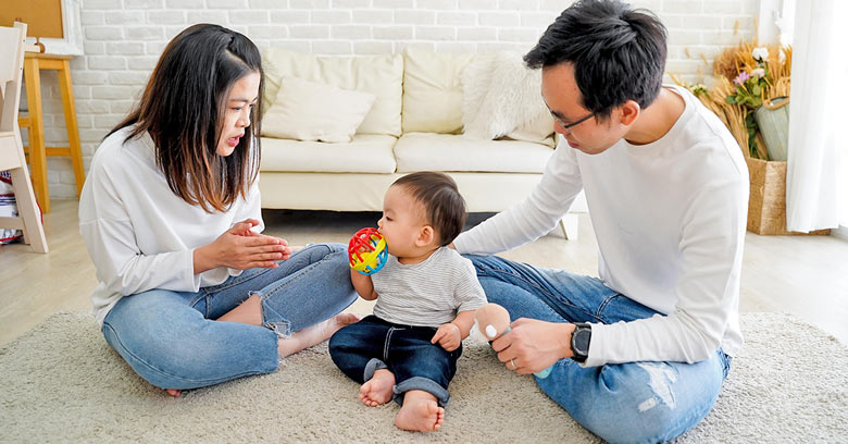 Chinese parents playing with a baby