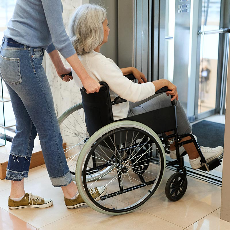 Woman entering an accessible home lift