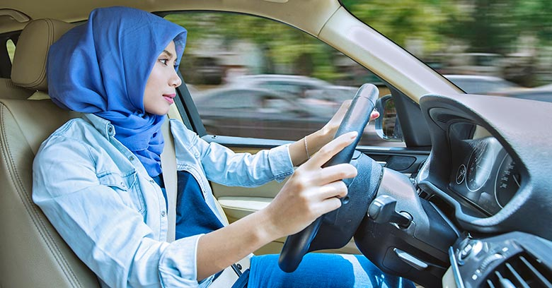 Indonesian woman driving a car